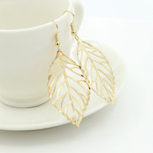 2019 Pendientes Mujer New Fashion Wholesale Jewelry Hollow Metal Leaves Dangling Long Statement Drop Earrings For Women Bijoux(China)