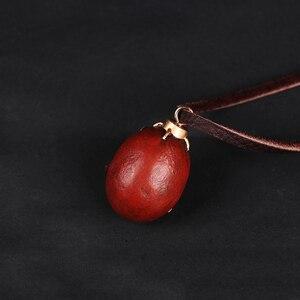 Image 5 - Collar Griffith Berserk Behelit Crimson Beherit Guts Beheritto The Egg Of The King con cuerda de cuero, tipo activado, 1997