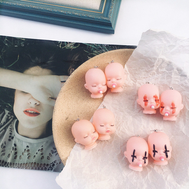 Sleeping Baby Head Earrings