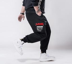 Image 2 - בתוספת גודל 7xl 6xl 5xl מכנסיים מטען גברים מוצק צבע שחור Loose מקרית Jogger כיס אלסטי מותניים קרסול אורך מכנסיים