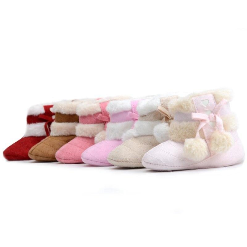 Invierno infantil bebé niñas suave de peluche botas lindo Anti-Slip cómoda nieve Bowknot corazón patrón con bola de pelusa botas Zapatos