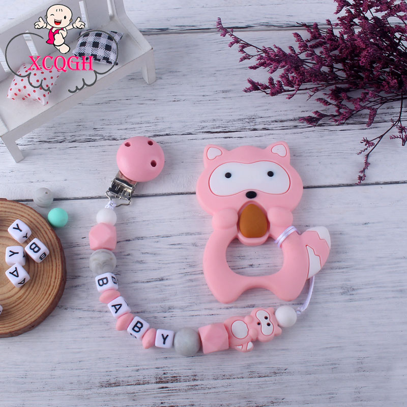 XCQGH 2Pcs/set Cute Animal Pendant Raccoon Silicone Teether And Baby Teething Pacifier Leash Strap