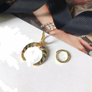 Image 5 - Umgodly moda brincos amarelo cor de ouro assimétrico multicolorido zircão listras lua crescente tribal brincos hoop feminino jóias