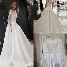 Тюлевое свадебное платье трапециевидной формы с высоким вырезом
