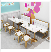 Table and chair combination of card seat sofa in milk tea shop
