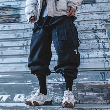 Odzież damska męska Harajuku nieorganiczne taktyczne spodnie w stylu Cargo kilka kieszeni luźne pluszowe zimowe ponadgabarytowe Jogger streetwear Hiphop tanie i dobre opinie fayi Cargo pants CN (pochodzenie) Mieszkanie Wstążki Pełnej długości W stylu Safari Polar Elastyczny pas