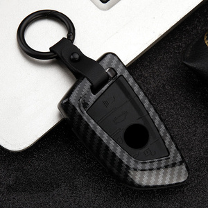 Image 2 - 2019 Fashion ABS PC Carbon Fiber Silica Gel Car Key Cover Case For BMW X5 F15 X6 F16 G30 7 Series G11 X1 F48 F39 Hotcar keychain