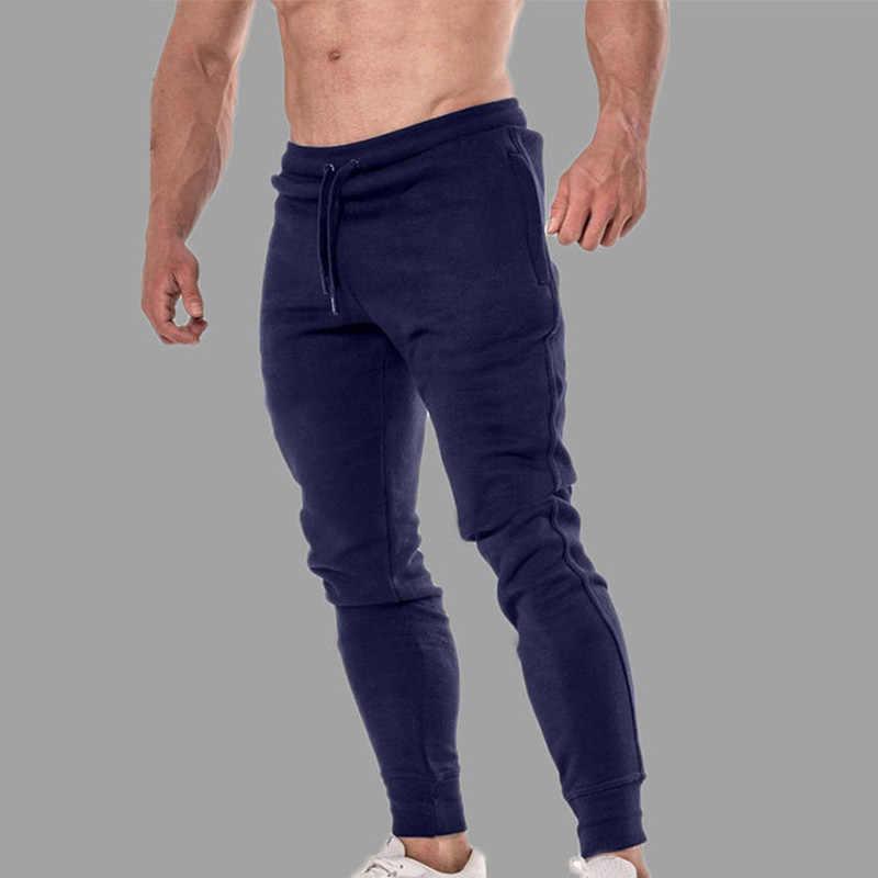 男性のスポーツジョギングパンツ綿通気性ランニングスウェットパンツテニスサッカー再生ジムズボンポケットカスタムロゴ