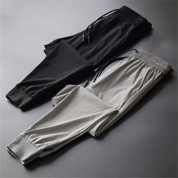Męskie spodnie joggery męskie spodnie streetwear spodnie męskie spodnie bojówki męskie męskie spodnie dresowe bawełniane pełnej długości tanie i dobre opinie Proste Mieszkanie Mikrofibra Modalne CASHMERE COTTON NONE REGULAR LK-PN009 Na co dzień Midweight Suknem Elastyczny pas