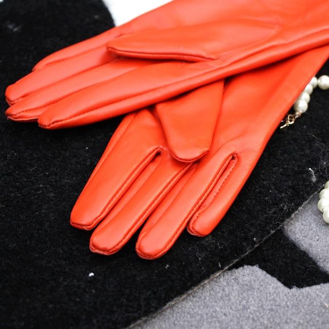 Фото оранжевые женские перчатки теплее длинные натуральные кожаные