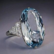 Huitan الإناث ضوء السماء الزرقاء خاتم الزواج سوليتير الفرقة البيضاوي حجر إشراك حفلة النساء مجوهرات فاخرة تألق تشيكوسلوفاكيا حجر أفضل هدية