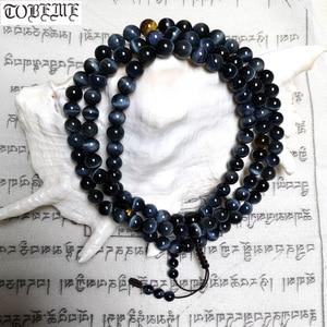 Image 1 - Tybetański projektant Mala prawdziwy niebieski tygrysie oko kamień koraliki Mala tybetański Hawk Eye kamień różańce buddyjski modlitwa 108 koraliki