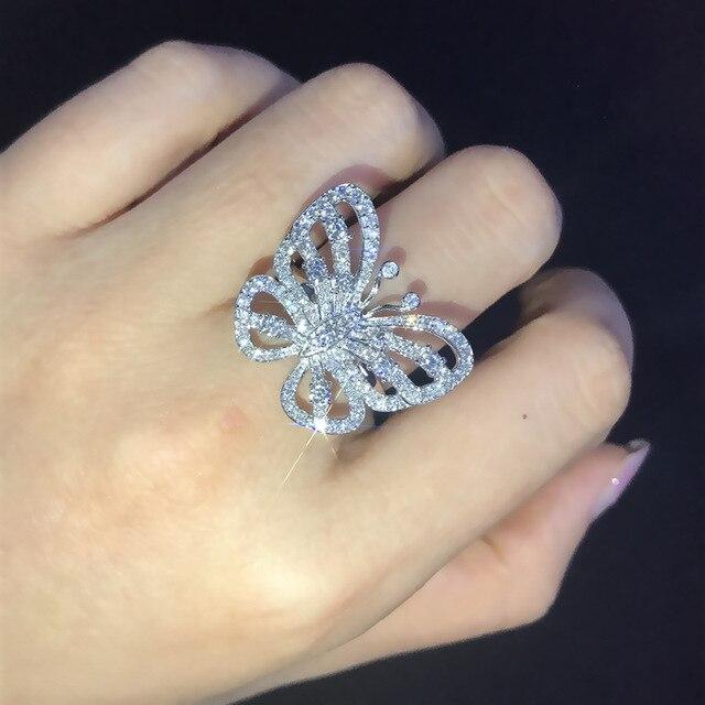 Фото женское обручальное кольцо с бабочкой обручальное серебряного цена