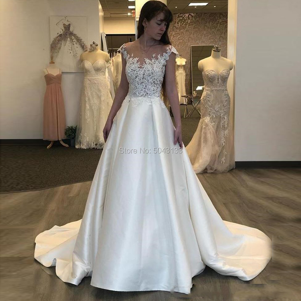 Elegant Satin A Line Wedding Dresses 2020 Sheer Scoop Cap Sleeves Bridal Wedding Gowns Sexy Backless Lace Appliques Bride Dress
