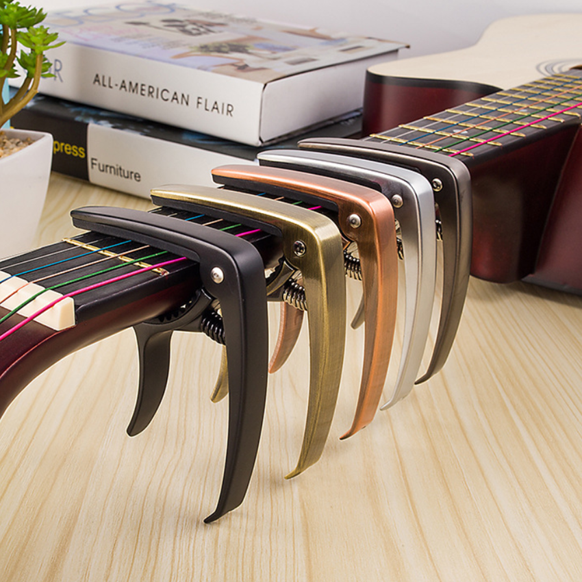 Zinc Alloy Guitar Capo Is A Capo Ballad Guitar Ukulele Gold Pullable String Nail Musical Instrument Accessories Parts