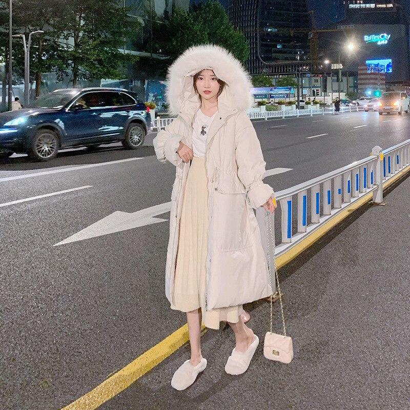 Match Super raton laveur cheveux plomb 2019 hiver bas vestes tendance couleur unie même chapeau personnalité Long fonds