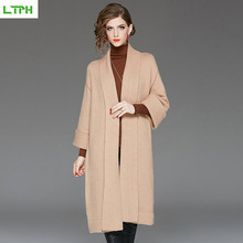 2019 autumn and winter new elegant high-end womens lapel trumpet sleeve knit cardigan solid color Medium long Slim fit coat