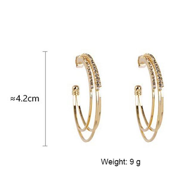 Женские круглые серьги кольца с кристаллами