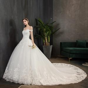 Image 3 - Neue Ankunft Süße Elegante Prinzessin Luxus Spitze Hochzeit Kleid 100 cm Boot ausschnitt Appliques Promi Ballkleid vestido De Noiva
