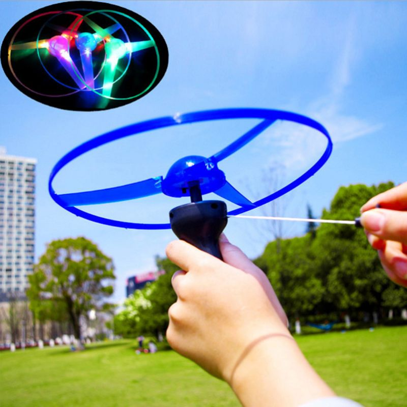 1 Piece LED Flashing Plastic Pull String Flying Saucer Propeller Toy Disc Helicopter New