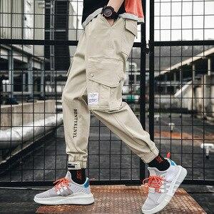 Image 2 - סתיו חדש היפ הופ רצים גברים שחור הרמון מכנסיים רב כיס סרטי איש מכנסי טרנינג Streetwear מקרית Mens מכנסיים S 3XL