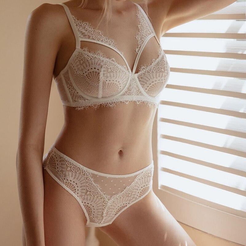 Комплект прозрачного женского сексуального нижнего белья с бюстгальтером и кружевными вставками