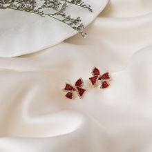 2020 nuovi orecchini pendenti Bowknot in metallo di moda Senior contratti orecchini da donna in cristallo rosso lucido lucido fresco