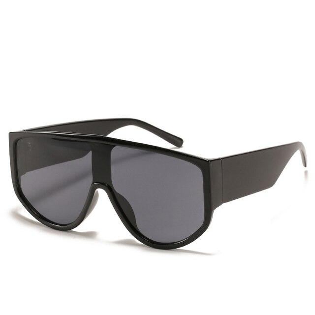 Фото новейшие трендовые цельные солнцезащитные очки большого размера