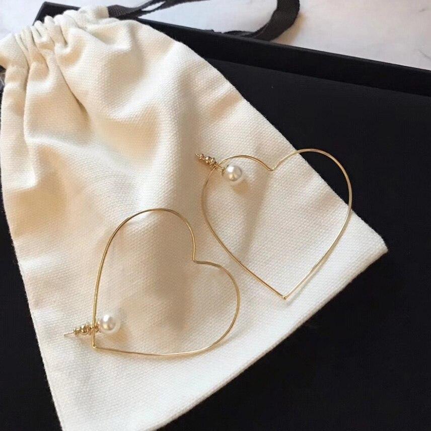 Boucles d'oreilles INS mode chaude européenne marque originale Collection piste concepteur à la mode perle plaqué or femmes boucle d'oreille goujon