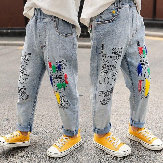 高品質のカラーペイント子供ジーンズガールズボーイズ手紙ジーンズ少年少女のための秋の子供服、子供のジーンズ 3 13 年齢