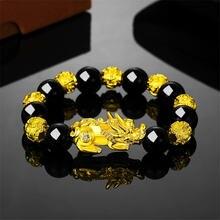 Браслет унисекс золотистый черный с бусинами из камня