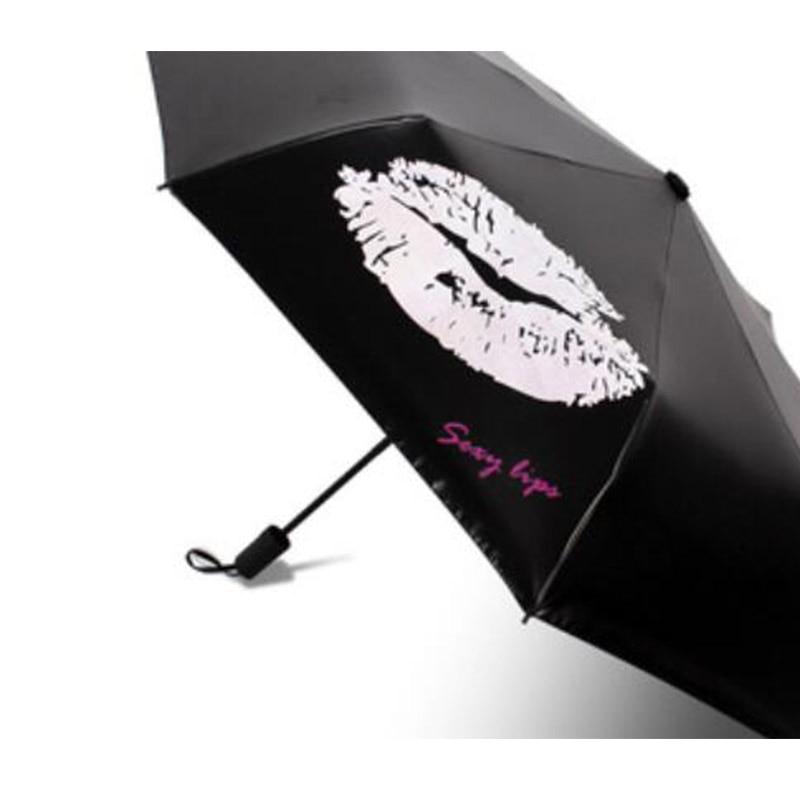 2019 nouvelle personnalité magique parapluie pluie changement de couleur noir en plastique crème solaire pliant trois fois parapluie facile à transporter
