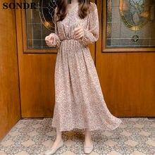 Элегантное женское платье с v образным вырезом и цветочным принтом