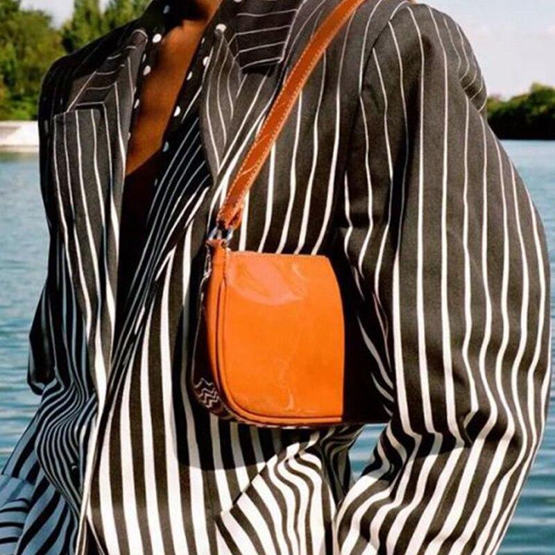 Niche designer bag new Rachel bag patent leather shoulder bag glossy soft leather baguette bag