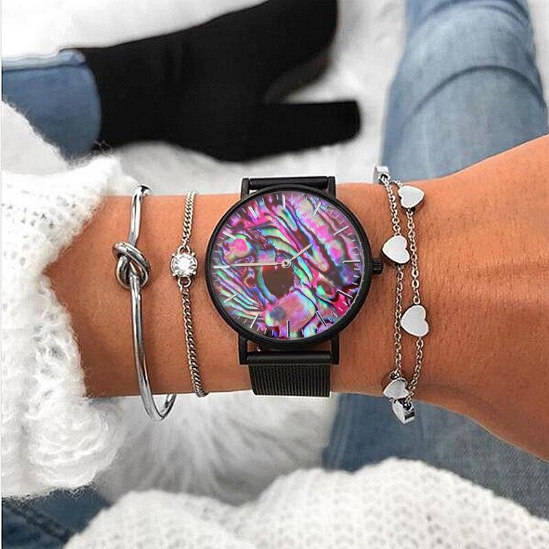 relógio de pulso com malha de aço