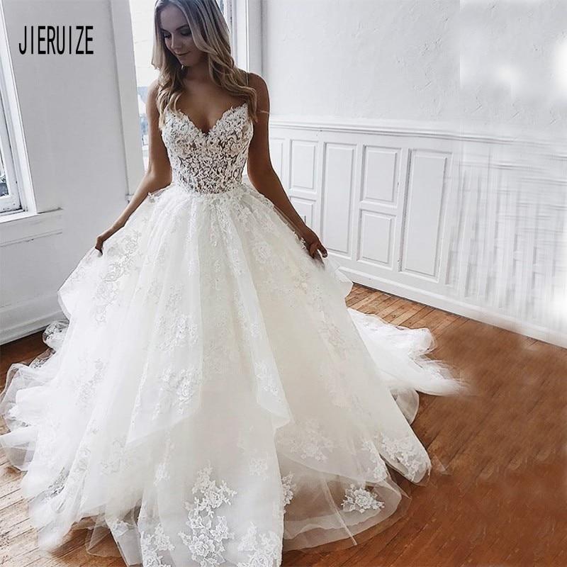 JIERUIZE Beach Wedding Dresses Spaghetti Straps Sexy Backless Illusion Lace Applique Bridal Gowns With Ruffles Robe De Mariée