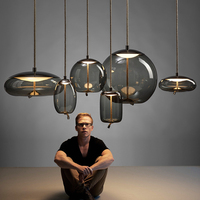 https://ae01.alicdn.com/kf/H850ac33d830b474e91a9bcc787bcae954/Modern-Led-Metal-Pendant-Lights-Wrought-Iron-Glass-Round-Ball-Brass-Rod-Hanging-Lamp-For-Living.jpg