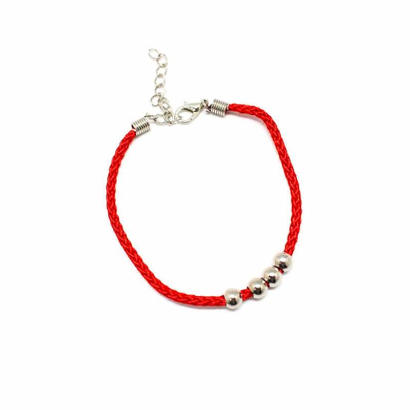 1 pièce ethnique-Style Natal pour hommes et femmes Couple tissé à la main perlé quatre perles rouge corde réglable Bracelet mode bijoux