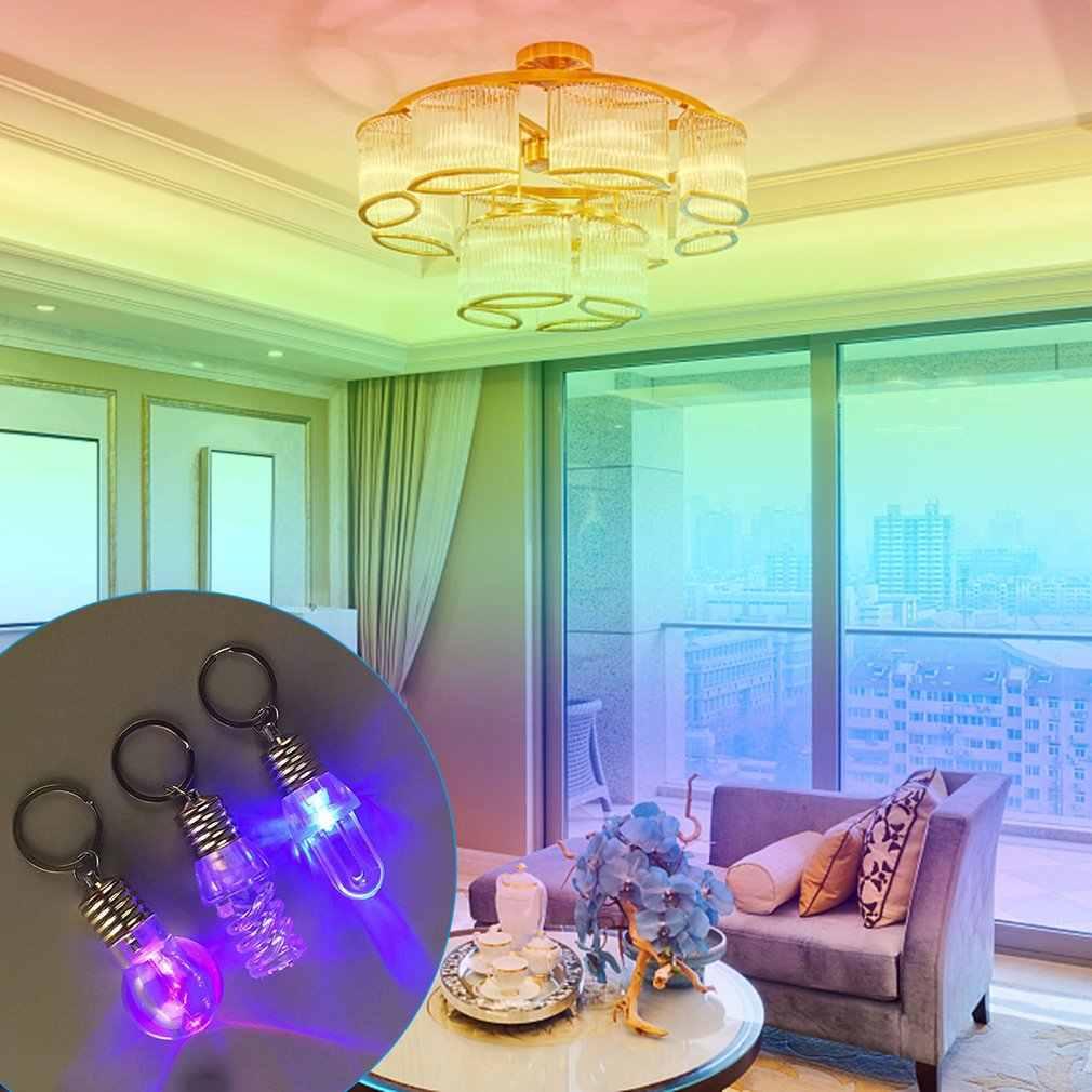 ICOCO ตลกหลอดไฟ LED พวงกุญแจสีสันแฟลชเกลียว Key CHAIN สีสันไฟฉายพวงกุญแจส่องสว่างโคมไฟของเล่น Drop Ship
