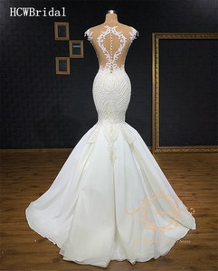 Image 2 - Dubai Luxury Mermaid Wedding Dress 2019 Exquisite Sleeveless Floor Length See Through Back Arabic Wedding Gowns Custom Made