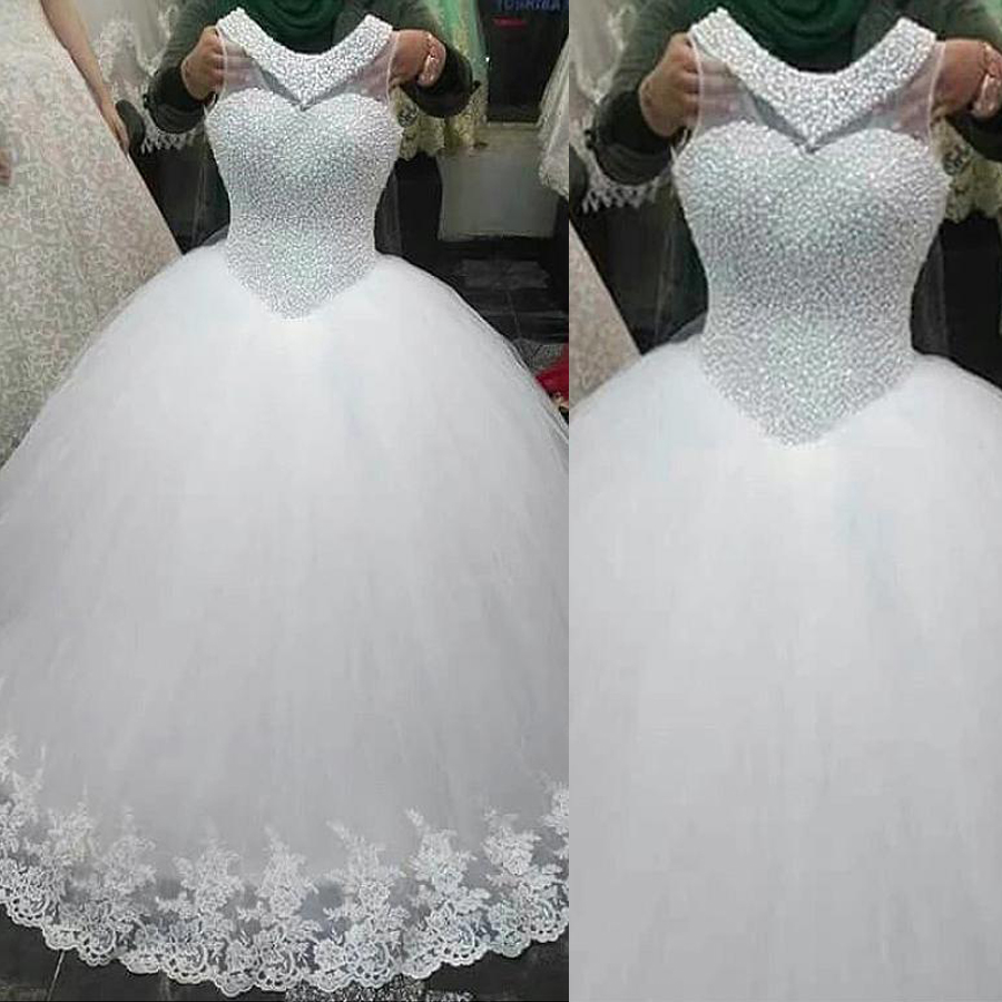 Exquisite Tulle Jewel Neckline Ball Gown Wedding Dresses With Pearls Beading Sleeveslss Crystals Bridal Gowns
