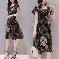 Женское облегающее платье-трапеция с цветочным принтом и U-образным вырезом