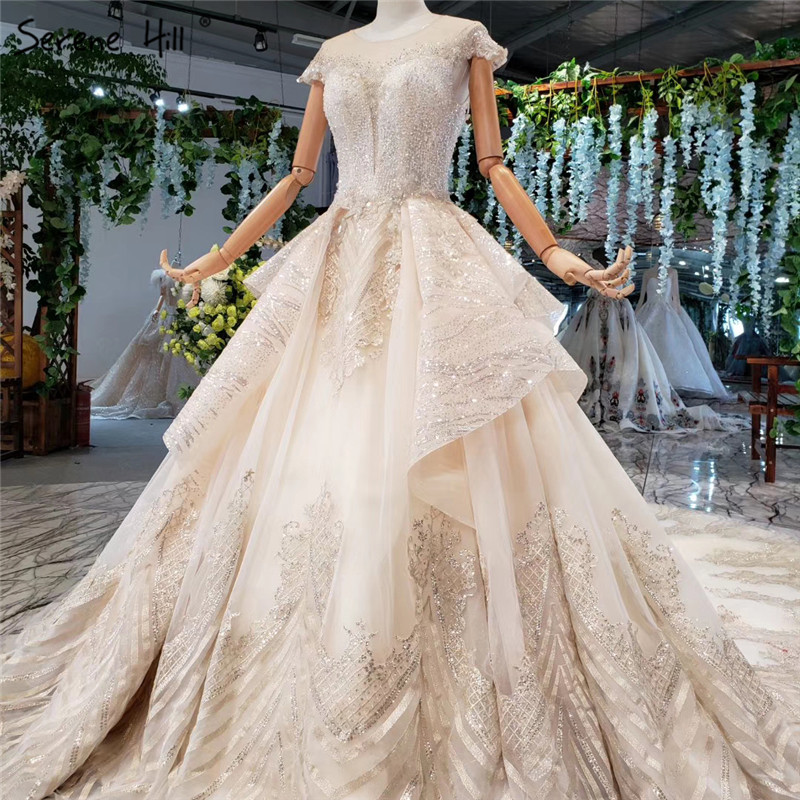 Champagne Sleeveless Luxury Wedding Dresses 2019 Dubai O-Neck Sequined Beading Bridal Gowns HX0006 Custom Made