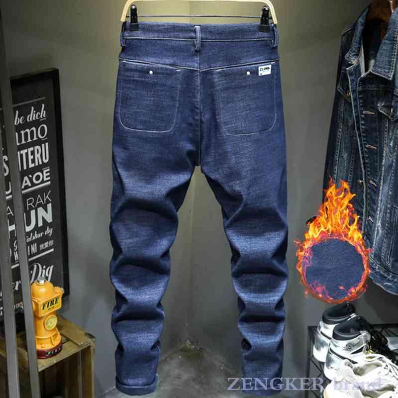 Zimowe czarne z połyskiem aksamitne dżinsy męskie rozciągliwe stopy niebieskie męskie zagęszczone ciepłe spodnie męskie 10XL 9XL męskie spodnie jeansowe