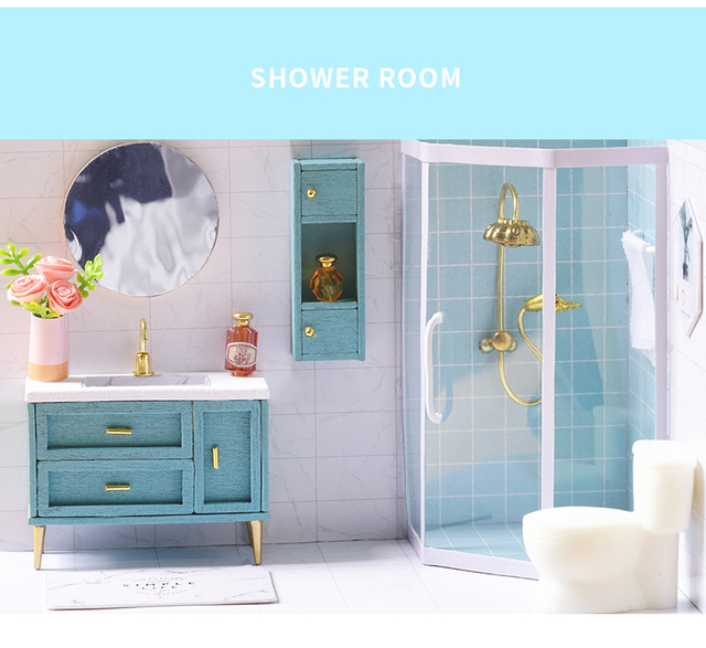 bathroom of the blue doll house, shower, toilet, mirror and vanity with items