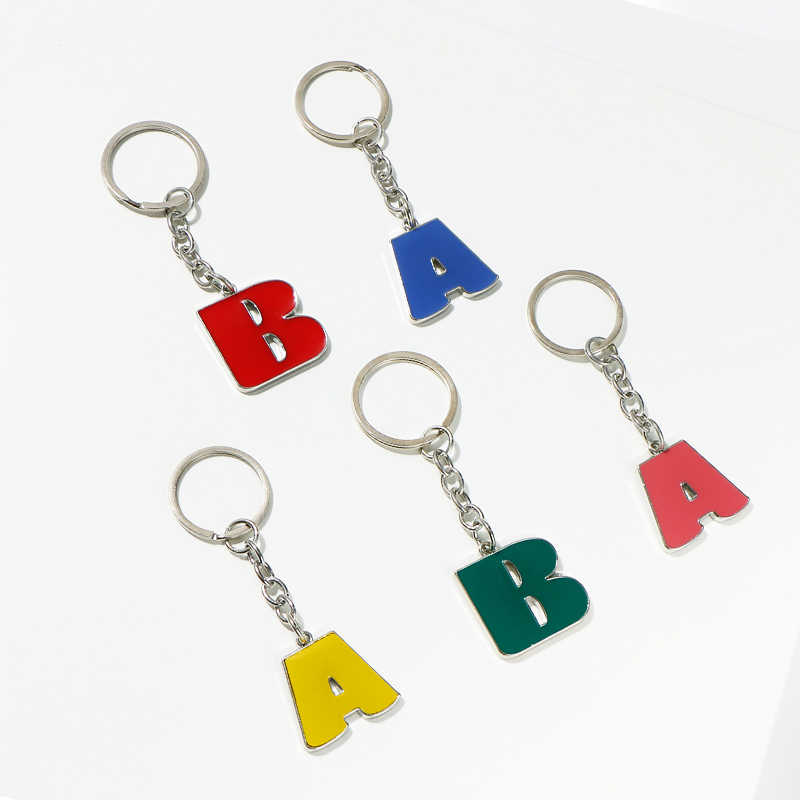 Komi A-Z alfabeto chaveiro carta inicial chaveiro homem mulher chaveiro anel titular do carro 26 letras a10123