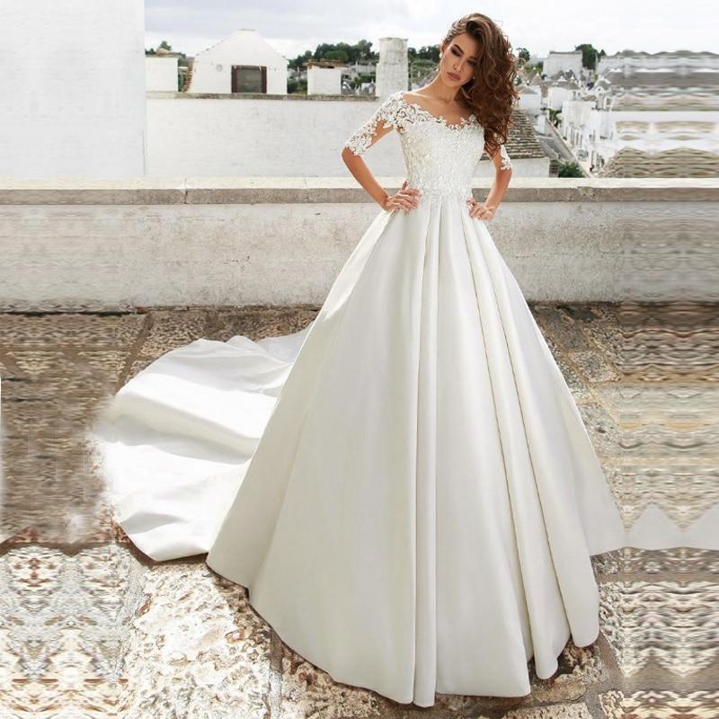 Princes Turkey Half Sleeves Wedding Dresses Appliques Lace Illusion Back Bridal Dress Vestidos De Noiva Wedding Gown With Train