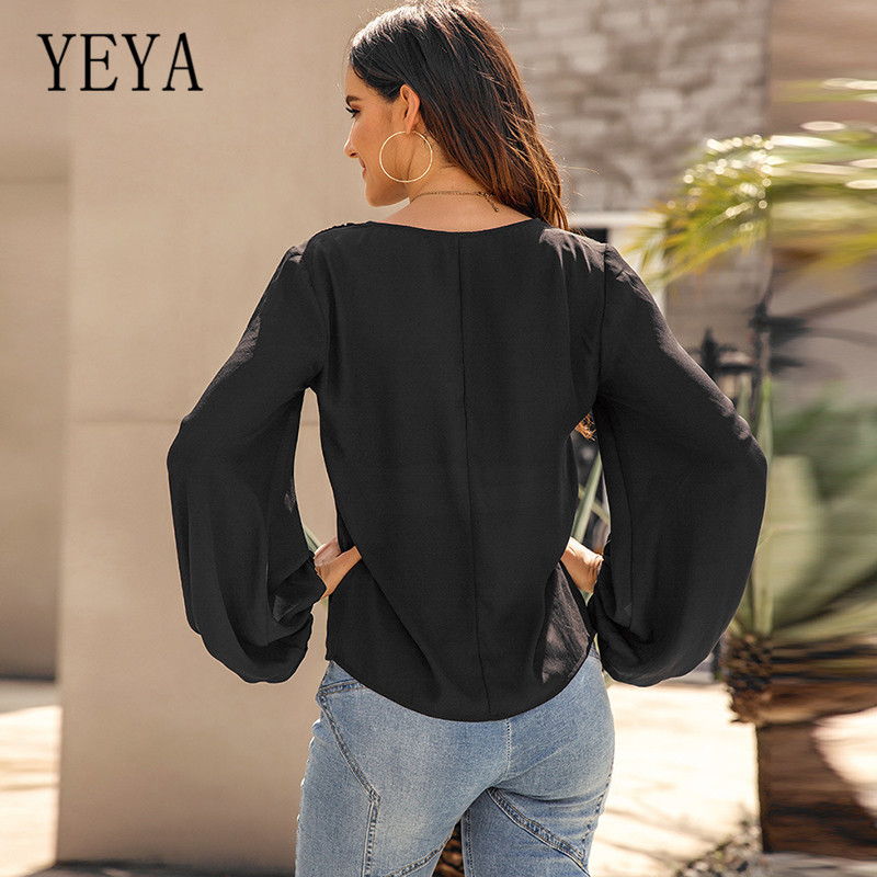 YEYA Solid V neck One Button Lantern Sleeves Casual Loose Personality Cross T shirt Top Elegant Hollow Out Femme Casual Top in T Shirts from Women 39 s Clothing