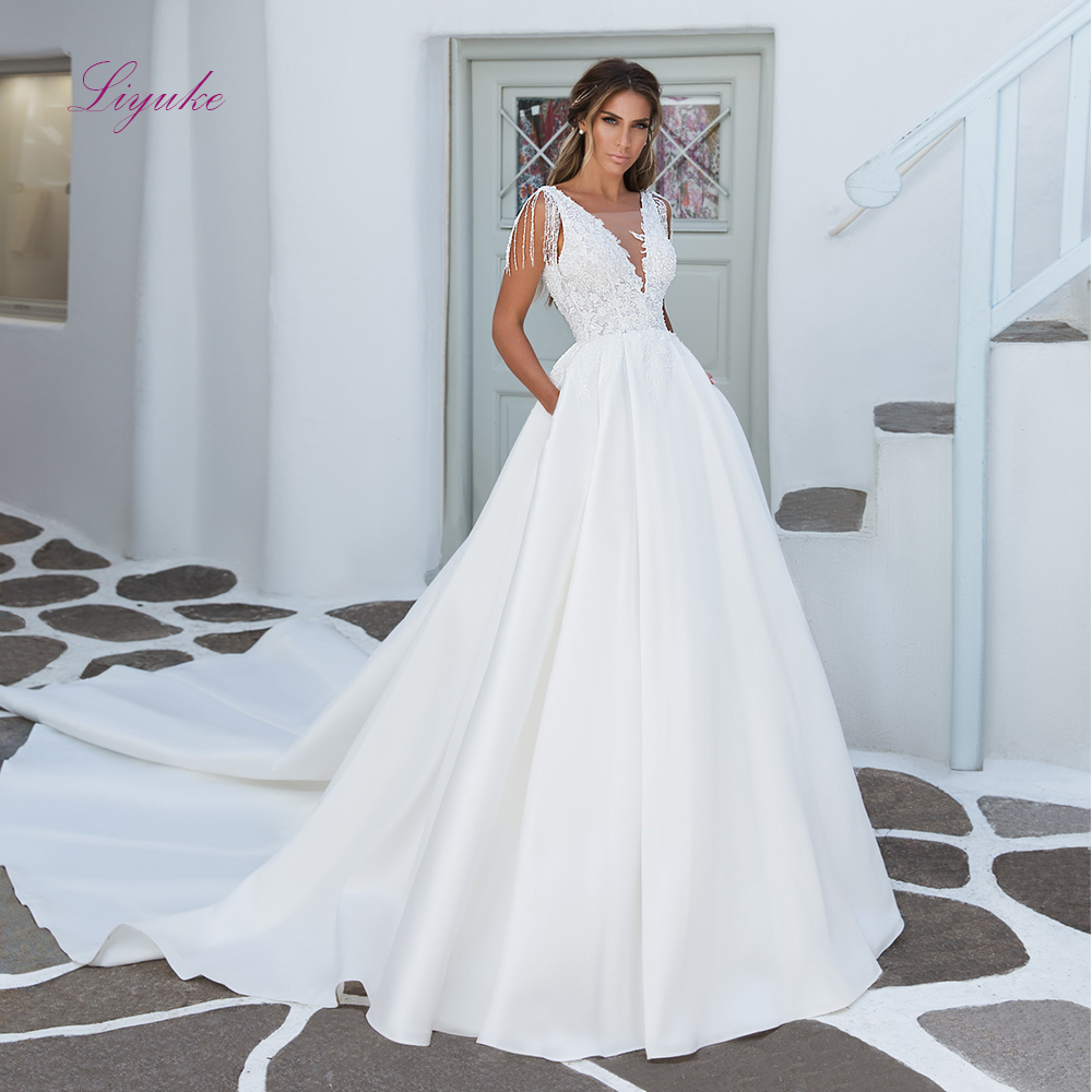 Liyuke 2019 Married A-line Wedding Dress Scalloped Neck Lace Appliques Pearls Sequined Tassel Backless Customized Floor Length