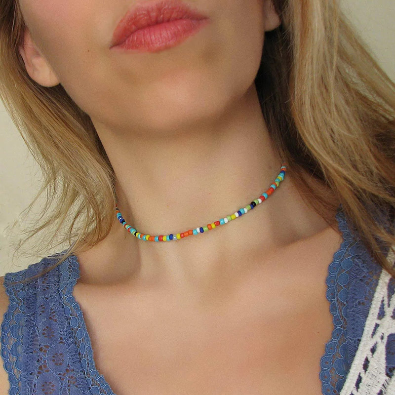 Beaded loom jewelry set Seed bead Choker and bracelet with  red and blue roses with black borders on a white background
